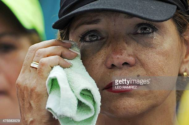 An antigovernment demonstratorwipes her tears during a protest in eastern Caracas on February 28 2014 The death toll from more than three weeks of...
