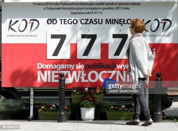 An anti-government protest billboard is seen close to the Polish Prime Minister's office in Warsaw on April 25, 2018. - It shows how many days have...