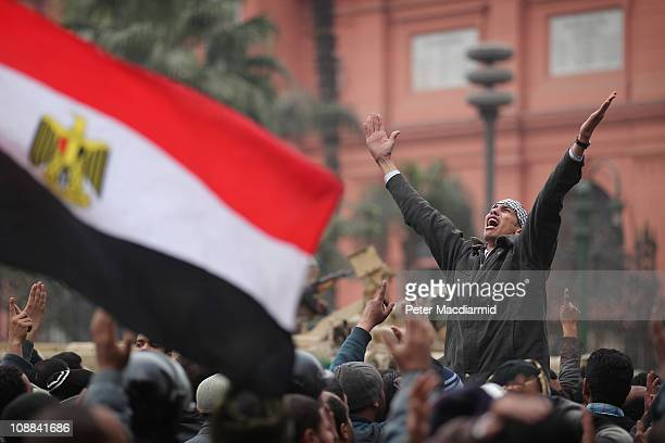 An antigovernment protester chants and gestures in front of soldiers guarding the Egyptian Museum in Tahrir Square on February 5 2011 in Cairo Egypt...