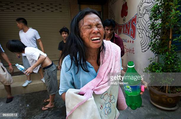 An antigovernment protester grimaces from the effects of tear gas fired by Thai military forces during street clashes on May 14 2010 in Bangkok...