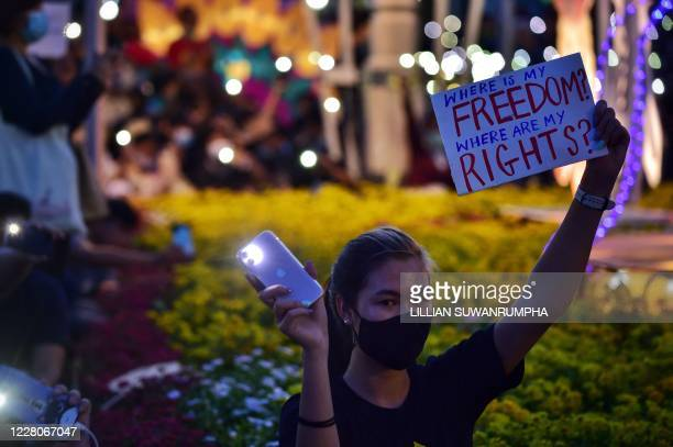 An antigovernment protester holds a sign during a rally at Democracy Monument in Bangkok on August 16 2020 Protesters gathered for a rally in Bangkok...