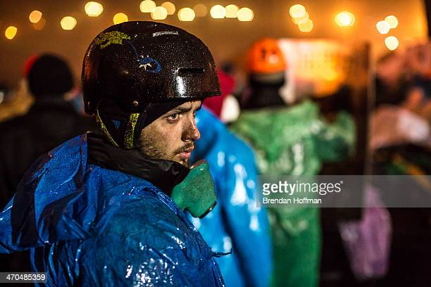 An antigovernment protester on Independence Square on February 19 2014 in Kiev Ukraine After several weeks of calm violence has again flared between...