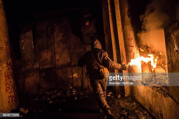 An antigovernment protester prepares to throw a Molotov cocktail during clashes with police on Hrushevskoho Street near Dynamo stadium on January 24...