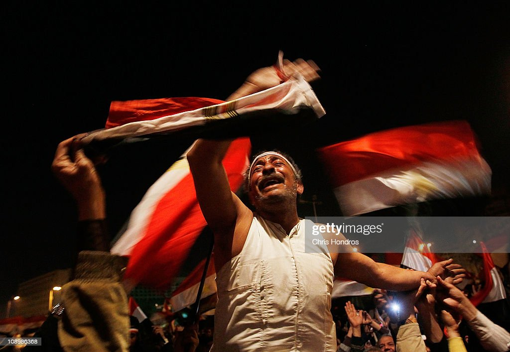 An anti-government protester reacts before Egyptian President Hosni Mubarak was to make a statement February 10, 2011 in Cairo, Egypt. Egyptian President Hosni Mubarak made a statement in which he refused to step down, defying expectations that he was preparing to resign.