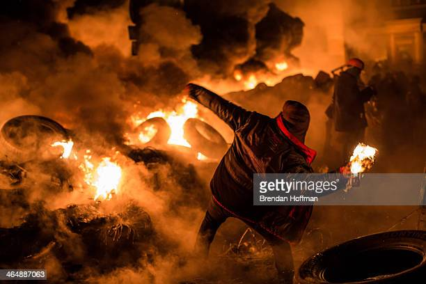 An antigovernment protester throws a Molotov cocktail during clashes with police on Hrushevskoho Street near Dynamo stadium on January 25 2014 in...