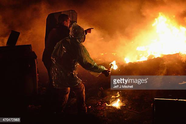 An antigovernment protester throws a molotov cocktail during demonstrations in Independence Square on February 19 2014 in Kiev Ukraine After several...
