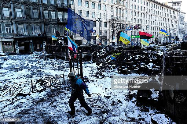 An antigovernment Protester walks in front of a barricade on Grushevskoho Street on January 30 2014 in Kiev Ukraine Ukraine's Prime Minister Mykola...