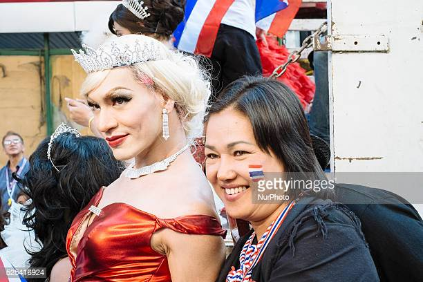 An antigovernment protesters poses with a Thai ladyboy during the first day of the shutdown of the Thai capital The blockade of Bangkok is the last...