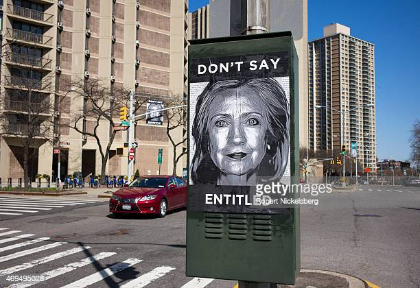 An antiHillary Clinton poster is affixed to a traffic light across the street from the purported Clinton campaign headquarters on April 12 2015 in...