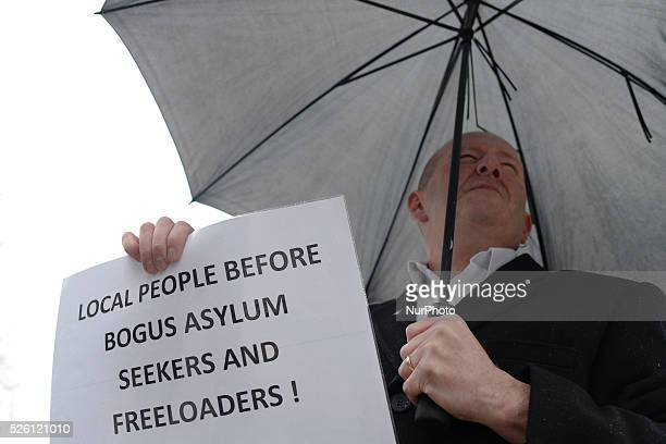An antiislamic protester during a protest against refugees coming to Northern Ireland Belfast City Hall Northern Ireland UK On Saturday 5 December...