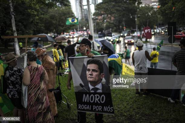 An antiLula demonstrator holds a sign that reads 'Moro Pray For Us' referring to 'Carwash' judge Sergio Moro in Porto Alegre Brazil on Wednesday Jan...