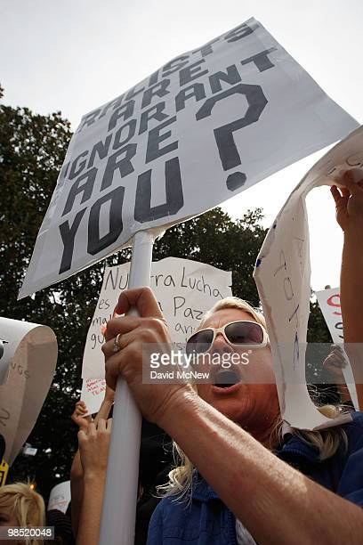 An antineoNazi demonstrator protests during a National Socialist Movement rally near City Hall on April 17 2010 in Los Angeles California An NSM...