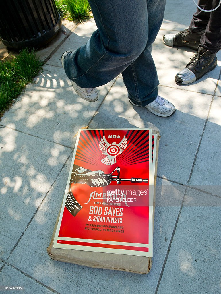 An anti-NRA (National Rifle Association) poster is seen at a rally April 25, 2013 in Washington, DC. The NRA is lobbying against gun reforms laws being debated in the US Congress. AFP PHOTO/Karen BLEIER
