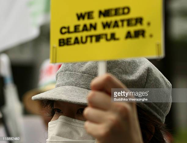 An antinuclear activist holds a placrad at a protest against nuclear energy on June 11 2011 in Osaka Japan The Japanese government has been...