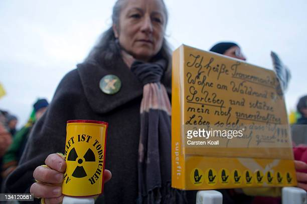 An antinuclear activist takes part in a mass rally on November 26 2011 in Dannenberg Germany A train carrying the Castor containers of processed...