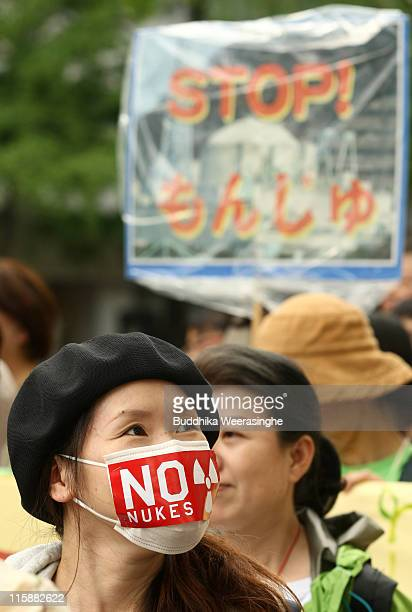 An antinuclear activist wears mask that read NO NUKES at a protest against nuclear energy on June 11 2011 in Osaka Japan The Japanese government has...