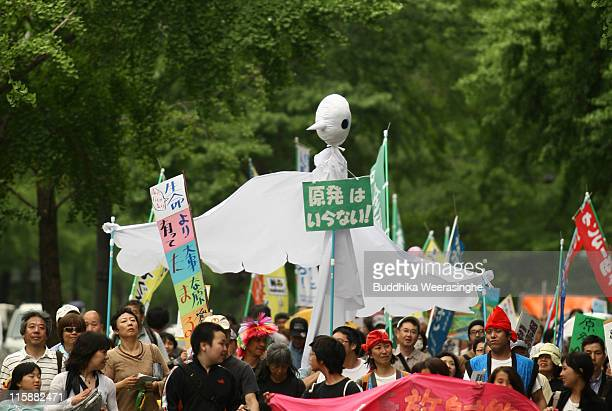 An antinuclear activists hold a pigeon at a protest against nuclear energy on June 11 2011 in Osaka Japan The Japanese government has been struggling...
