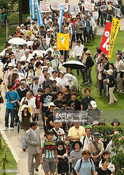 An antinuclear activists march at a protest against nuclear energy on June 11 2011 in Osaka Japan The Japanese government has been struggling to deal...