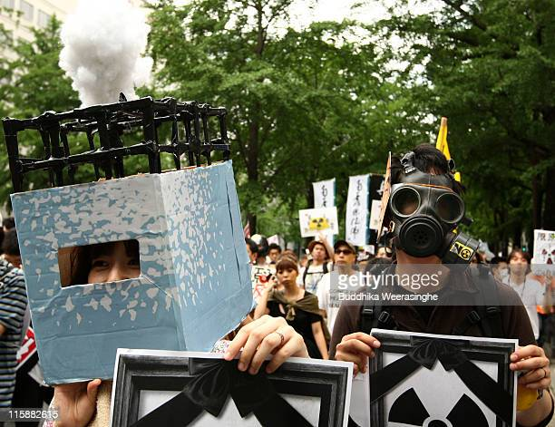 An antinuclear activists take a part at a protest against nuclear energy on June 11 2011 in Osaka Japan The Japanese government has been struggling...