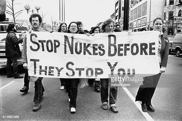 An antinuclear rally in Boston Massachusetts following the partial nuclear meltdown at Three Mile Island April 1979 The banner reads 'Stop nukes...
