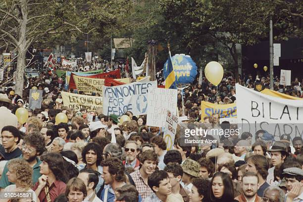 An antinuclear rally in Central Park New York City 12th June 1982 Among the banners is one by the 'Mennonites for Peace'