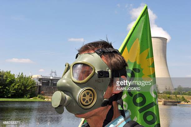 An antinuclear supporter member of EuropeEcologyGreens party participates in a demontration on June 3 2011 in Civaux center France to protest against...