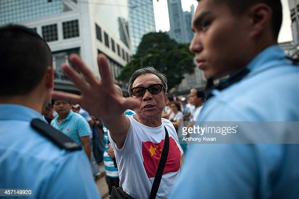 An antioccupy protester shouts at prodemocracy demonstrators at Central on October 13 2014 in Hong Kong Prodemocracy supporters continue to occupy...