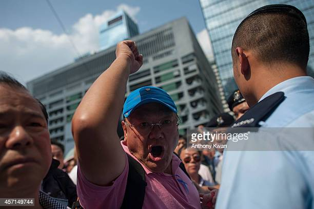 An antioccupy protester shouts prodemocracy demonstrators at Central on October 13 2014 in Hong Kong Prodemocracy supporters continue to occupy the...