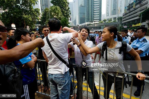 An anti-Occupy protester verbally abuse 'Occupy Central' protesters while two female police officers try to prevent him to, in Admirality on October...