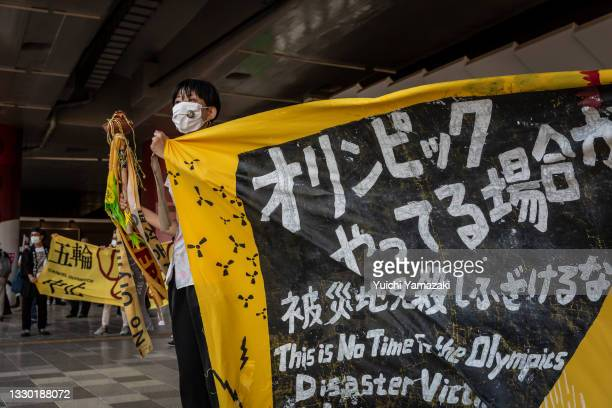 An anti-Olympics protester demonstrates against the Tokyo Olympics on July 23, 2021 in Tokyo, Japan. Protesters gathered to demonstrate against the...