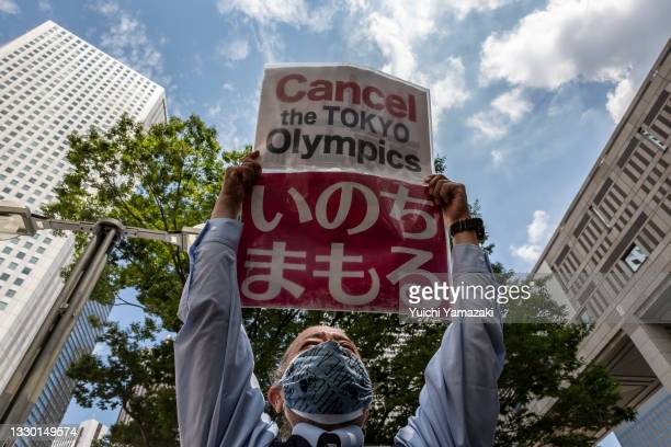 An anti-Olympics protester demonstrates during the Olympic Torch Relay Celebration event on July 23, 2021 in Tokyo, Japan. Protesters gathered to...