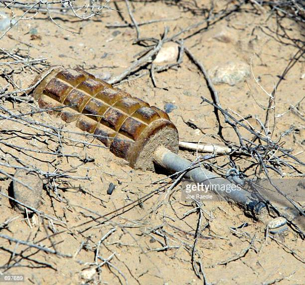 An antipersonnel mine that was allegedly left by Russian forces lays on the ground February 14 2002 on the perimeter of the Kandahar Airbase in...