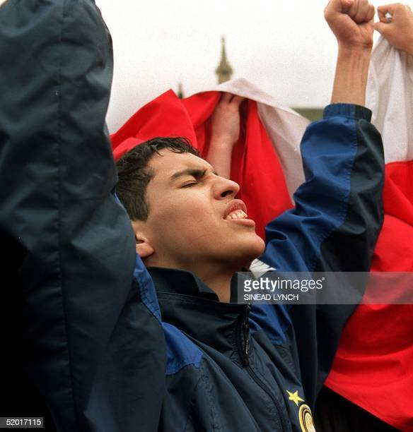 An anti-Pinochet demonstrator react outside the House of Lords 24 March 1999 after learning that Britain's highest court ruled by a majority of 6-1...