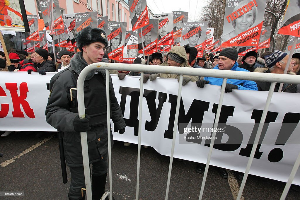 An anti-Putin rally crosses the street in central Moscow on January 13, 2012 in Moscow, Russia. Thousands of demonstrators gathered for a march to protest against a ban on Americans adopting Russian children.