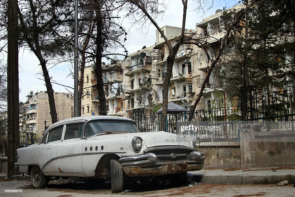 An antique car, one of the pieces of Antiquarian Syrian doctor Mohamed Mohideen Enis Abu Omar'a antique collection, parked on street in Aleppo, Syria on April 10, 2015. Despite the all negative effects of the war, Syrian doctor Mohamed Mohideen Enis Abu Omar, doesn't abandon any of the antique pieces of his collection including 24 antique cars and many priceless antiques.