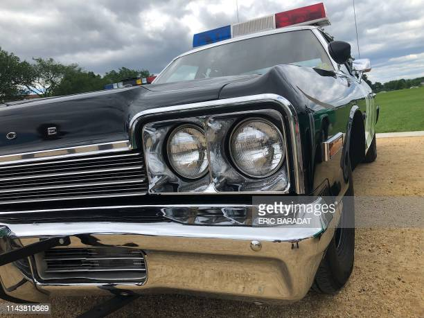 An antique Dodge Monaco California Highway Patrol Police car is displayed on the Washington Mall part of various events organized for National Police...