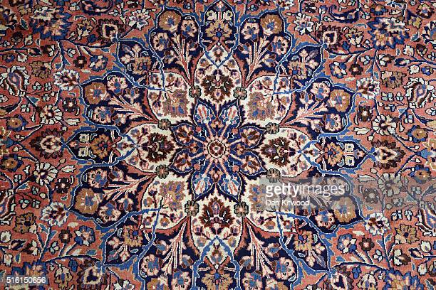 An antique 'Dorokhsh' Persian Rug is displayed in the Oriental Rug Centre's main warehouse on March 17 2016 in London England The Oriental Rug Centre...