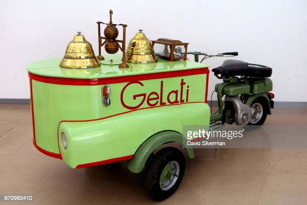 An antique Gelati vendor with freezer compartments for two flavors as well as a sauce dispenser and cone compartment built on a 1951 Lambretta 125 FC...