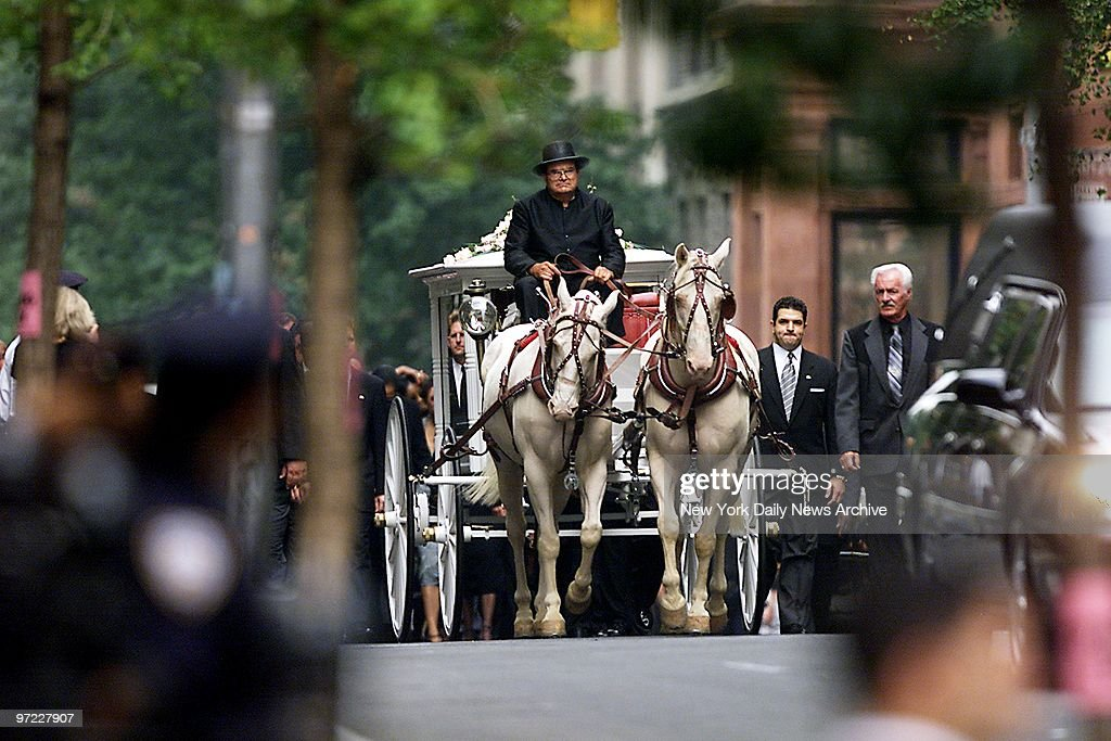 An antique glass-paneled carriage, pulled by a pair of cream : News Photo