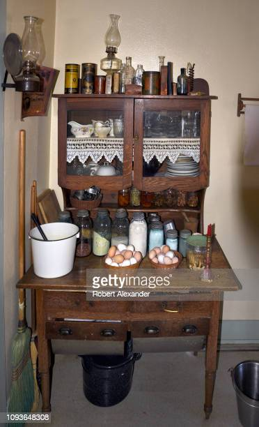 An antique kitchen hutch is still in use at the SauerBeckmann Living History Farm near Stonewall Texas Interpreters at the farmstead wearing period...