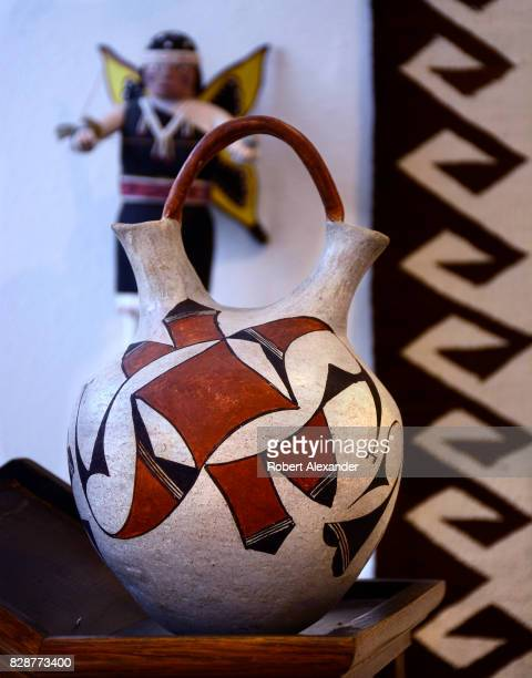 An antique Native American clay vessel made by a pueblo artist for sale in a shop in Santa Fe New Mexico