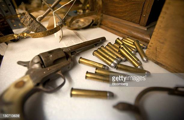 An antique pistol and bullets sit in storage at the wastetoenergy plant in Harrisburg Pennsylvania US on Friday Oct 28 2011 Harrisburg Pennsylvania's...