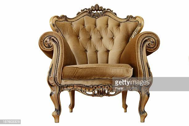 An antique rustic styled armchair on a white background
