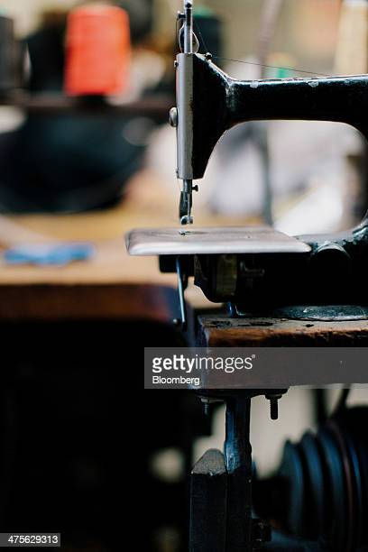 An antique Singer sewing machine stands at the Satya Twena Studio manufacturing facility in New York US on Monday Feb 24 2014 The Institute for...