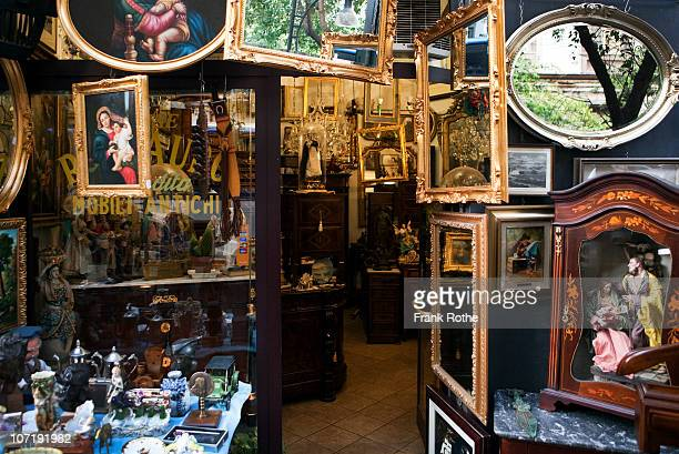 an antique store with old furniture, mirrors