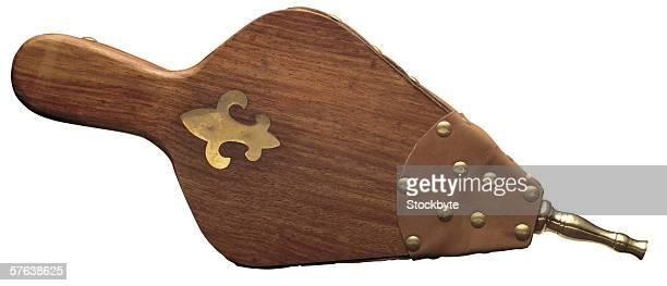 an antique wooden air blower