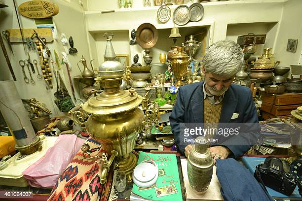 CONTENT] An antiques store owner shows his wares in the historic bazaar of Kashan Iran November 2012