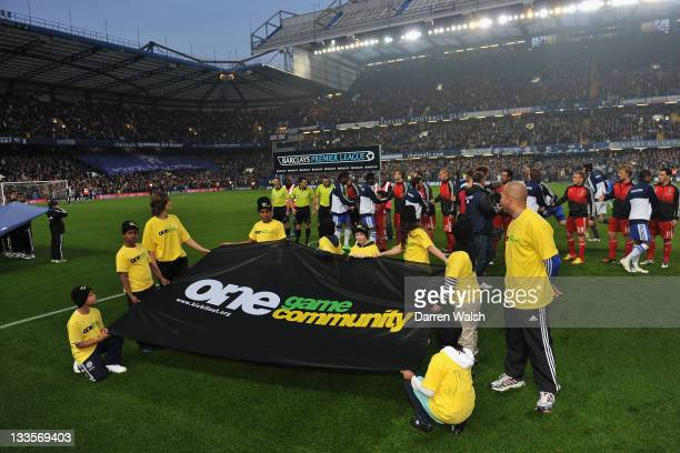 An AntiRacism campaign on the pitch as the players shake hands ahead of the Barclays Premier League match between Chelsea and Liverpool at Stamford...