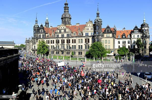 An antiracism protester attends a rally on August 29 2015 in Dresden stronghold of the antiIslam PEGIDA movement whose demonstrations drew up to...