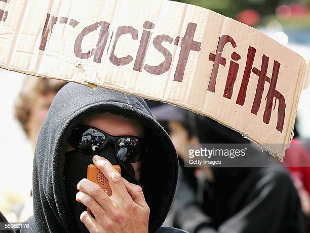 An antiracism supporter in the crowd makes their feelings known about the National Front during a New Zealand National Front party rally at the...